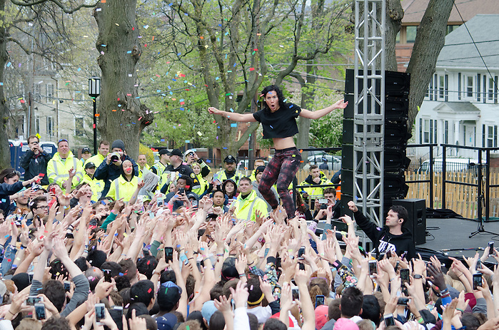 2016-05-01-Medford/Somerville-Tufts University-President's Lawn-The audience holds up Kim after Matt throws confetti into the air (Alex Knapp / The Tufts Daily). (Alex Knapp)
