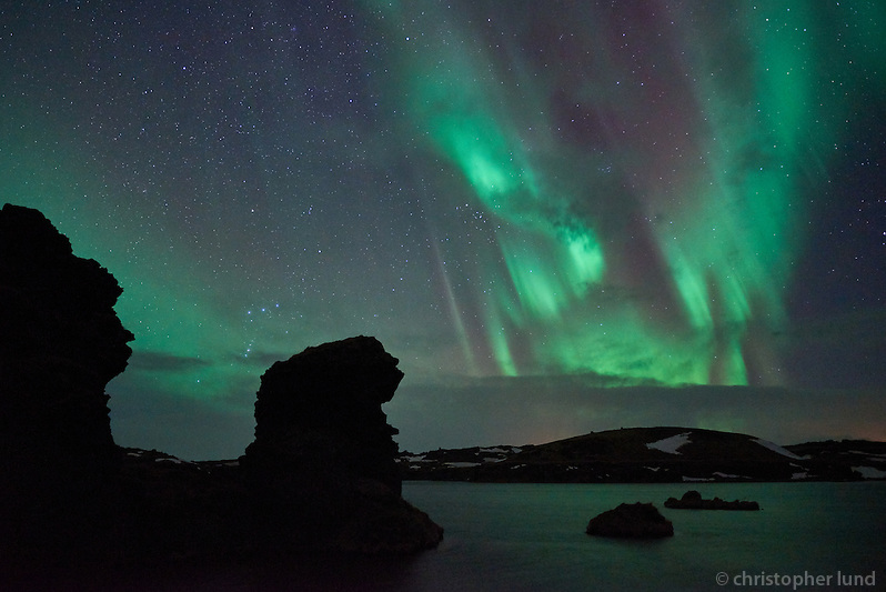 Northern Lights over Kálfastrandarvogur bay in Lake Mývatn. Kálfastrandavogur has unusual lava formations, both off- and onshore. These rocky outcrops are named Klasar and Kálfastrandarstrípar. (Christopher Lund/©2015 Christopher Lund)