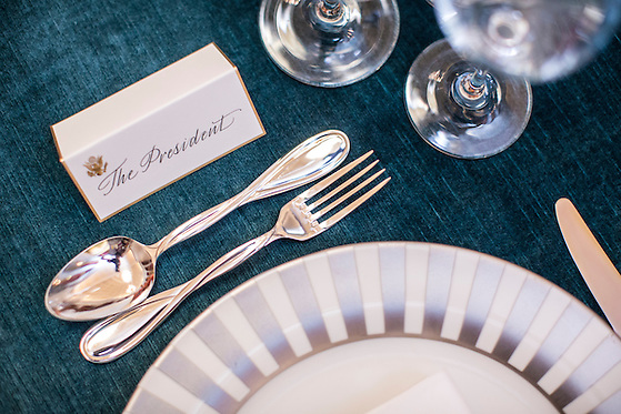 President Barack Obama's place setting is marked by a place card ahead of the Inaugural luncheon in Statuary Hall in the U.S. Capitol on Monday, January 21, 2013 in Washington, DC. (Brendan Hoffman/Brendan Hoffman for the New York Times)