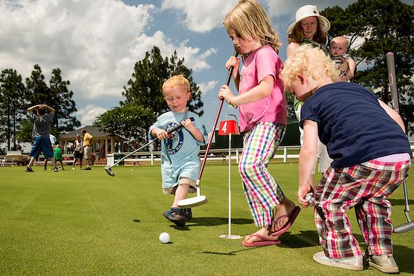 Children at a putting green during a practice round before the 2014 U.S. Open at Pinehurst Resort & C.C. in Village of Pinehurst, N.C. on Tuesday, June 10, 2014.  (Copyright USGA/Darren Carroll) (Darren Carroll/USGA Museum)