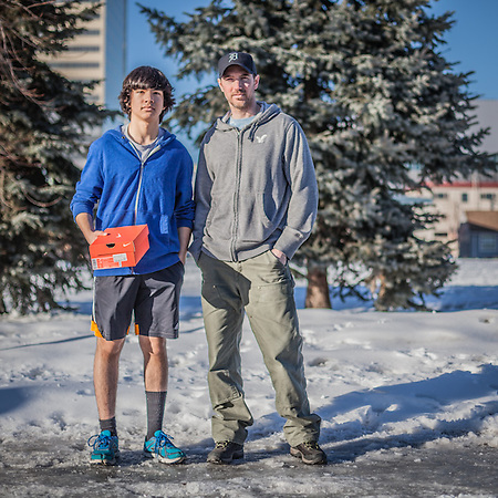 "Derik Peters and his fourteen year old son, Kenny, returning from downtown with a new pair of track shoes.  ""After eight years in Anchorage, we are thinking about moving back to Detroit."" (© Clark James Mishler)"