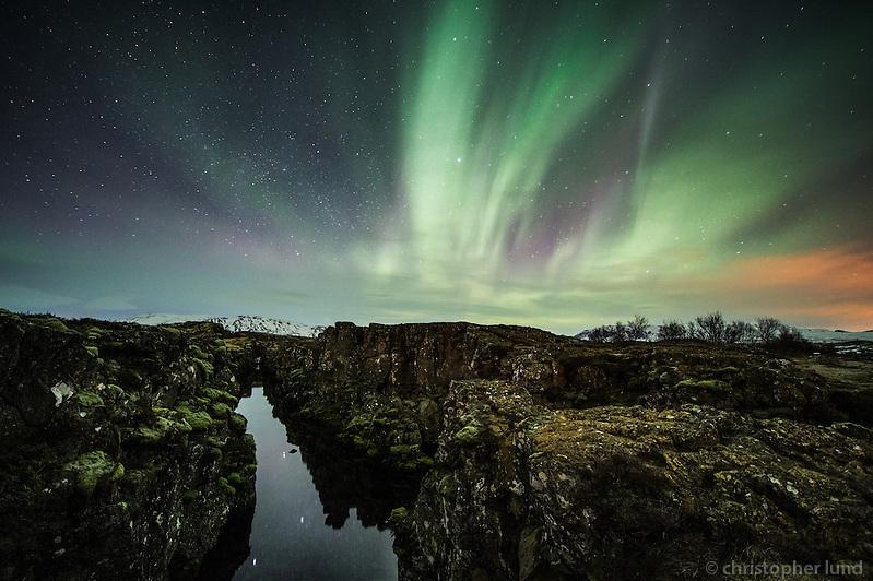 Northern Lights -Aurora Borealis over Flosagjá rift at �ingvellir National Park, South Iceland. (Christopher Lund/©2012 Christopher Lund)