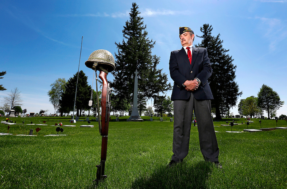 "Steve Livengood, a retired National Guardsman from Atlantic, stands in the  ""Field of Glory"", a plot of land reserved for veterans in the Atlantic cemetery.  Livengood, known as ""Mr. Military"" due to his heavy involvement in veterans and military activity in Atlantic, has been tapped to organize the upcoming Cass County Honor Flight for WWII veterans. (Christopher Gannon/The Register)"