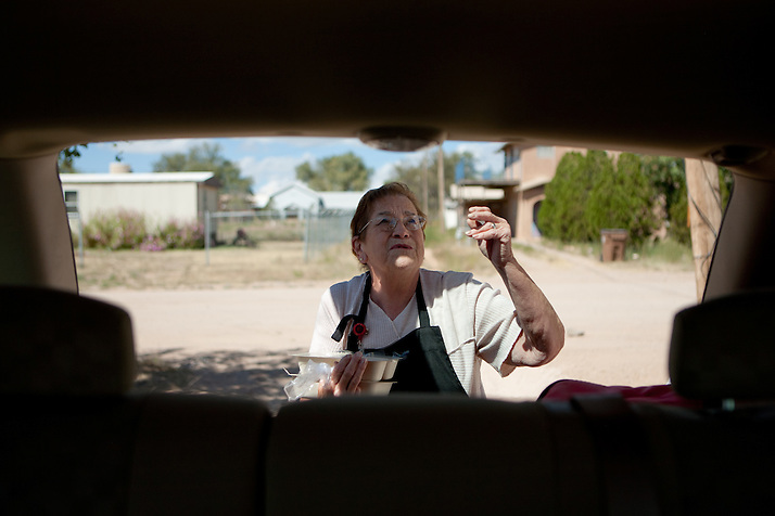 Bernis Chavez closes the hatch while holding meals to be delivered to Torrance County senior citizens. New Mexico has received more than $601,000 for senior meals programs around the state. (Steven St. John)