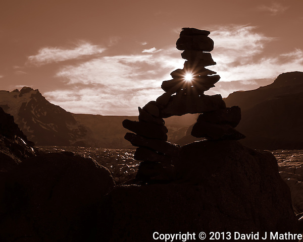 Sunburst Through a Rock Cairn Silhouette Overlooking a Glacier in Skaftafell National Park, Iceland. Image taken with a Leica X2 camera (ISO 100, 24 mm, f/11, 1/500 sec). (David J. Mathre)