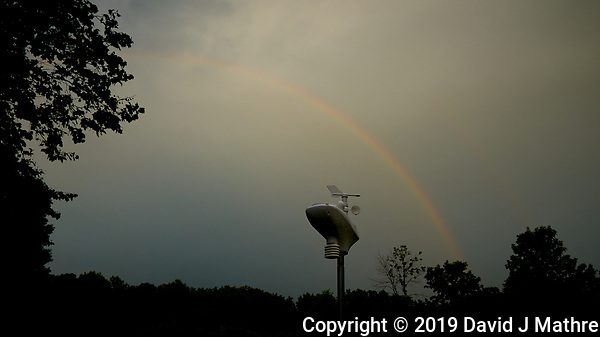 Backyard Evening Rainbow over the Weather Station. After the Thunderstorm. Image taken with a Leica CL camera and 11-23 mm lens (ISO 100, 11 mm, f/4.5, 1/640 sec). Raw image processed with Capture One Pro. (DAVID J MATHRE)