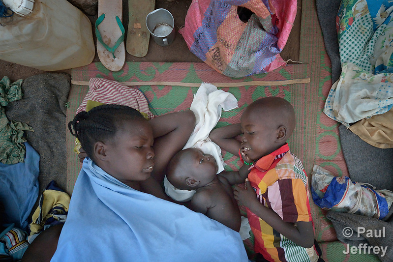 A mother and two of her children wake up after sleeping in the open in a camp for over 5,000 internally displaced persons in an Episcopal Church compound in Wau, South Sudan. Most of the families here were displaced by violence early in 2017, after a larger number took refuge in other church sites when widespread armed conflict engulfed Wau in June 2016. Norwegian Church Aid, a member of the ACT Alliance, has provided relief supplies to the displaced in Wau, and has supported the South Sudan Council of Churches as it has struggled to mediate the conflict in Wau. (Paul Jeffrey)