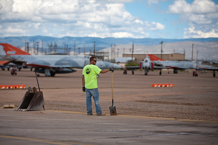 Laborer Jaysen Raymond pauses as construction crews at work building new runways at Holloman Air Force Base in Otero County. HAFB received over $21 million to upgrade various facilities as part of the Recovery and Reinvestment Act. (Steven St. John)