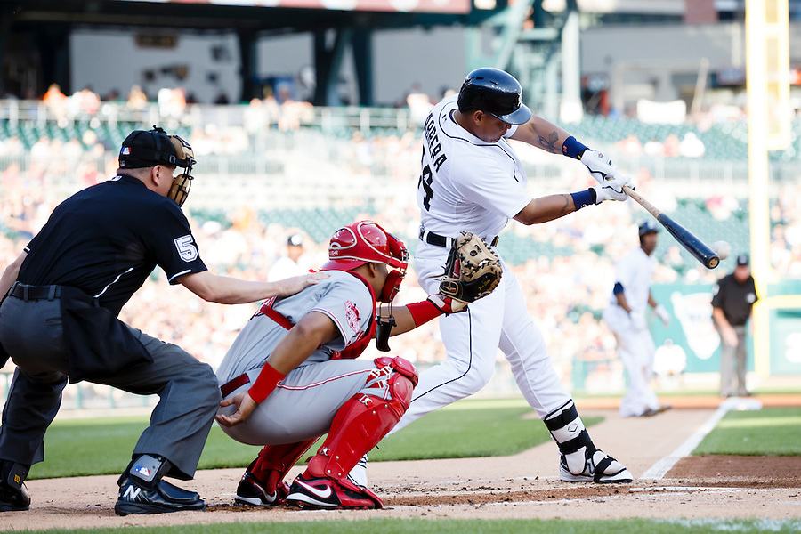 Jun 16, 2015; Detroit, MI, USA; Detroit Tigers first baseman Miguel Cabrera (24) hits an RBI single in the first inning against the Cincinnati Reds at Comerica Park. Mandatory Credit: Rick Osentoski-USA TODAY Sports (Rick Osentoski/Rick Osentoski-USA TODAY Sports)