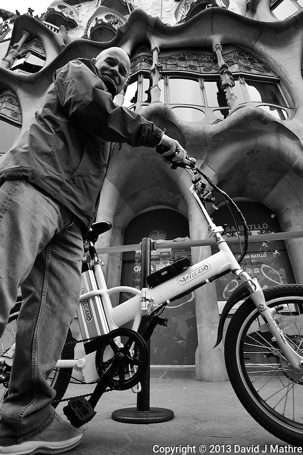 Xavi on His Bicycle in Front of Casa Batlló in Barcelona, Spain. Image taken with a Nikon 1 V1 and 6.7-13 mm VR lens (ISO 160, 6.7 mm, f/3.5, 1/400 sec).. (David J Mathre)