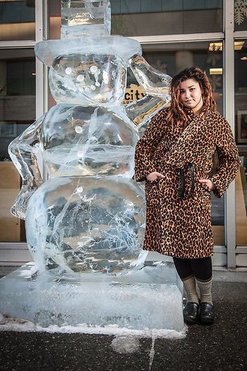 "Host Maya Dunham in front of Snow City Cafe with the cafe's ice sculpture.  mayadunham@hotmail.com  ""I grew up in Fairbanks.  Last August, I moved out of home and came to Anchorage…I found a job here and another job at Mooses Tooth…the two best places in town…I love it here."" (© Clark James Mishler)"
