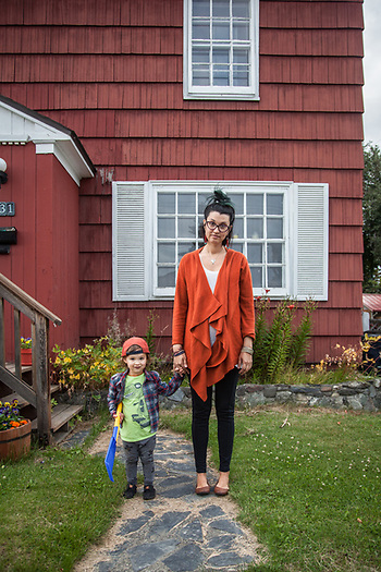 Keegan Richards with her two year old son, Gustav, in front of thier home in Anchorage's South Addition neighborhood  keegan.richards@gmail.com (© Clark James Mishler)