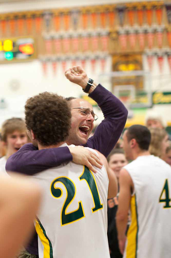 A parent celebrates after San Marin's upset victory against Bishop O'Dowd High School. (bryan farley)