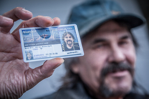 Richard George Gulbraa outside the DMV office with his brand new Alaska Identification card, downtown Anchorage. (Clark James Mishler)
