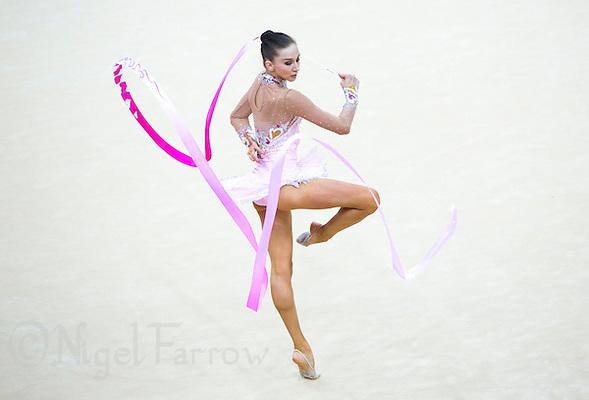 11 AUG 2012 - LONDON, GBR - Liubou Charkashyna (BLR) of Belarus performs her ribbon routine during the 2012 London Olympic Games Individual All-Around Rhythmic Gymnastics final at Wembley Arena in London, Great Britain (PHOTO (C) 2012 NIGEL FARROW) (NIGEL FARROW/(C) 2012 NIGEL FARROW)