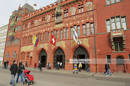 BASEL, SWITZERLAND - MARCH 01, 2009: Unidentified people walk in front of the Town Hall in Basel, Switzerland. (Dmitry Chulov)