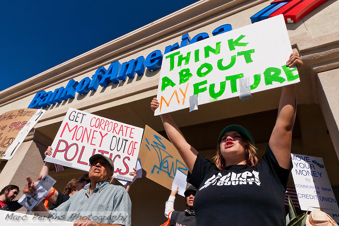 "Anastasia (right) and Adele (left front) hold signs and chant in front of a Bank of America in Irvine, CA during the Occupy Orange County, Irvine march on Saturday November 5.  Signs read ""Think about my future"", ""Get corporate money out of politics"" and ""Move your money to a community bank or credit union"" (Marc C. Perkins)"