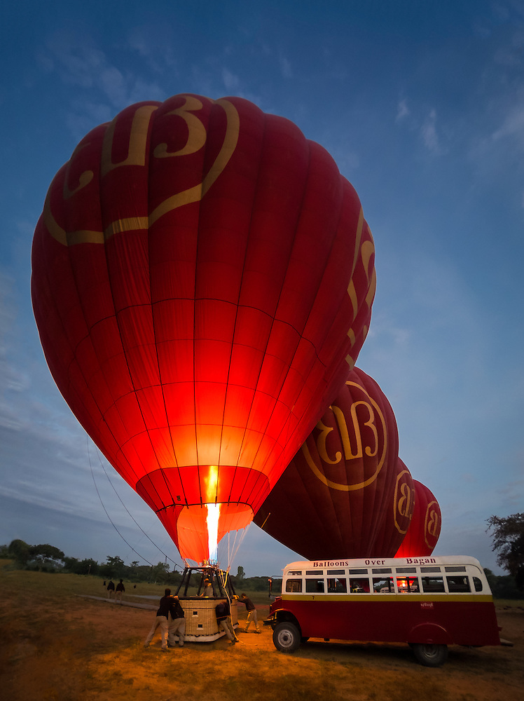 BAGAN, MYANMAR - CIRCA DECEMBER 2013: Hot air balloons getting ready to fly early morning in Bagan. (Daniel Korzeniewski)