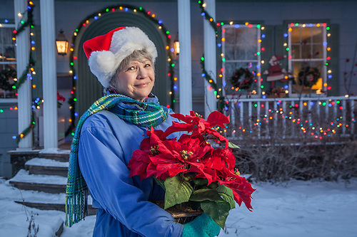 Lani Brennan on Christmas Eve in front of her home on G Street in Anchorage's South Addition neighborhood. (© Clark James Mishler)