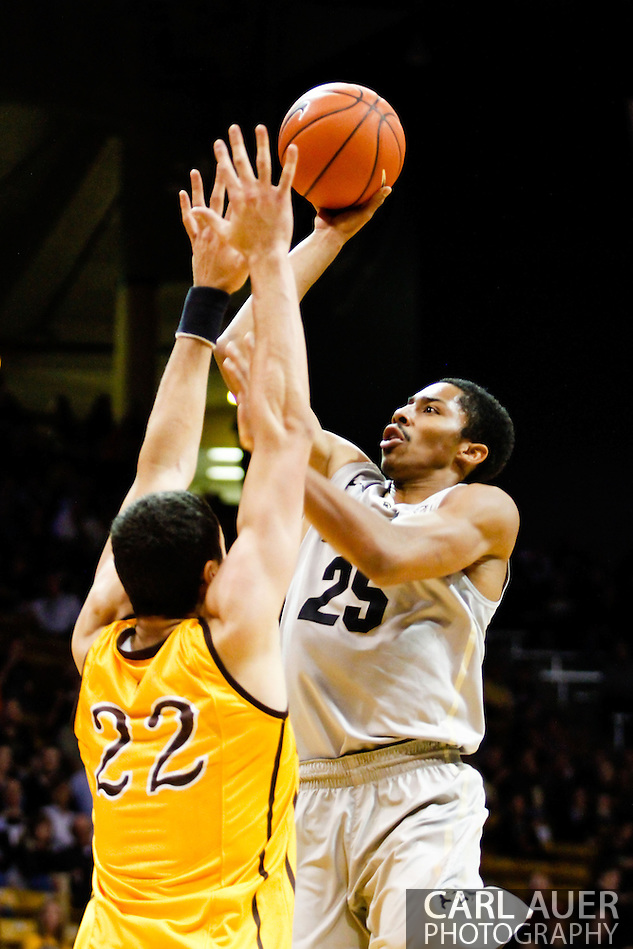 November 13th, 2013:  Colorado Buffaloes junior guard Spencer Dinwiddie (25) attempts a shot over University of Wyoming Cowboys junior forward Larry Nance Jr. (22) in the first half of the NCAA Basketball game between the University of Wyoming Cowboys and the University of Colorado Buffaloes at the Coors Events Center in Boulder, Colorado (Carl Auer/ZUMAPRESS.com)