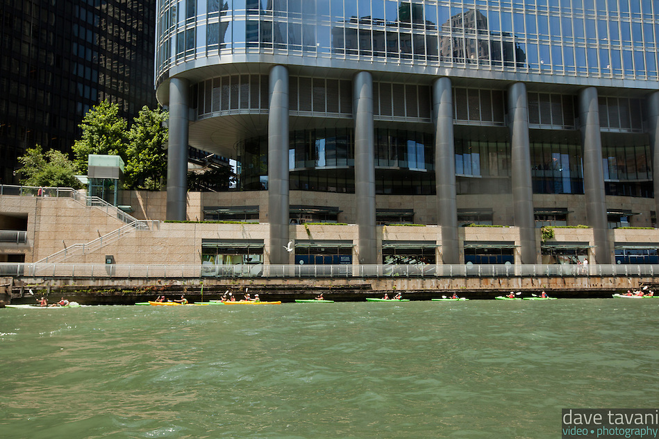 A raft of kayakers pass under the Trump International Hotel and Tower on the Chicago River. (Dave Tavani)