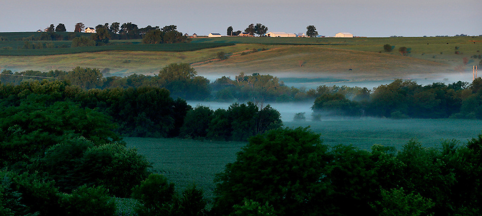 Fog blankets a valley at sunrise as seen from the Dammann Farm in Page County on July 3, 2014. (Christopher Gannon/The Register)