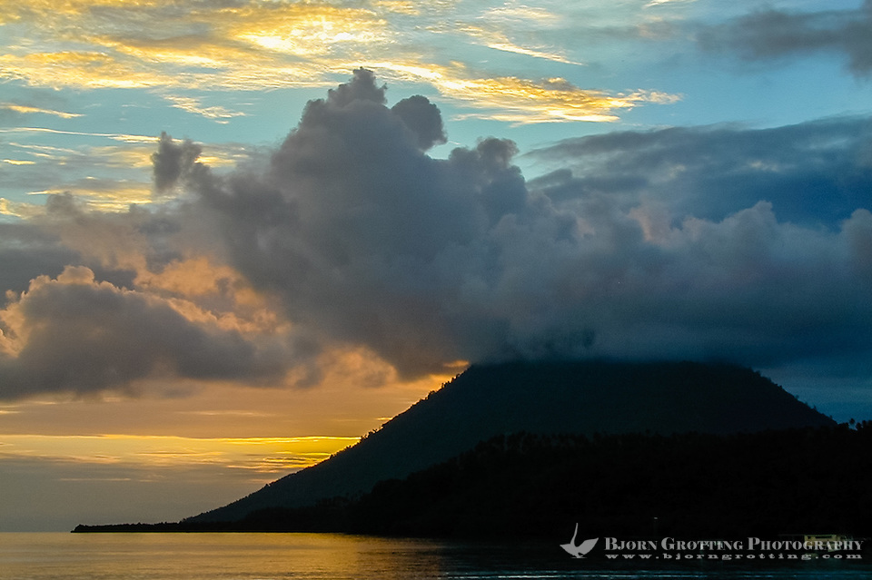 Indonesia, Sulawesi, Bunaken. Sunset at Bunaken. Manado Tua is a landmark with it