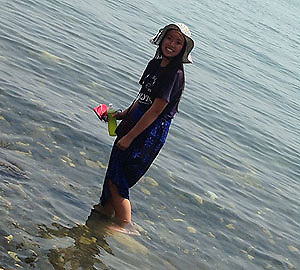 Rising senior Mai Pham (CVHS) wades in the Sea of Galilee. (Houston Independent School District)