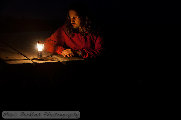 """A good friend who moved away last year gave me this windproof candle housing for backpacking.  While experimenting with night photography on a foggy night at the Lower Moro Campground at Crystal Cove I captured this picture of myself.  I call it, """"Thinking of you."""" (Marc C. Perkins)"""