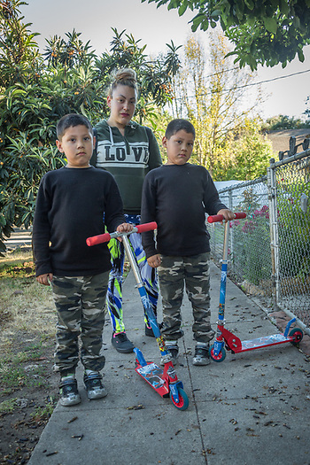 Elizabeth Sandoval with her six year old sons, Damian and Daniel, visit her mother's house in Calistoga (Clark James Mishler)