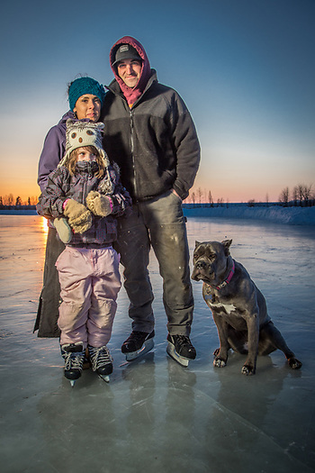 Matt Bennett, Gwen Gabbert and her daughter, Keira, on the ice at Westchester Lagoon, Anchorage (Clark James Mishler)