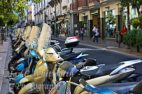 Scooters & motor bikes parked on a street in Italy. (Ian C Whitworth)
