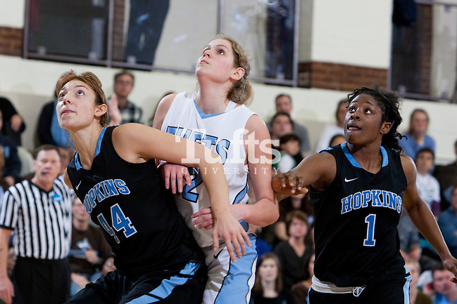 03/03/2012 - Medford, Mass. - Johns Hopkins forward Alex Vassila boxes out Tufts forward Hayley Kanner, A15, with some help from Johns Hopkins guard Fatu Conteh in Tufts' 55-46 win over Johns Hopkins in the second round of the NCAA Division III Women's Basketball Championship at Tufts University's Cousens Gymnasium on March 3, 2012. (Kelvin Ma/Tufts University)