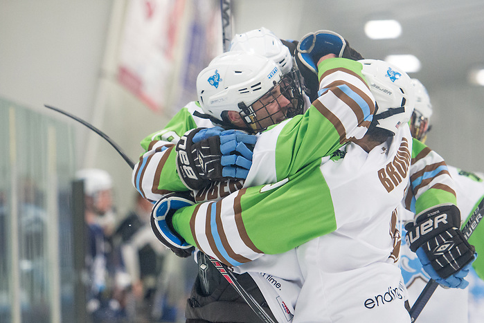 2/5/16 – Medford/Somerville, MA – Teammates congratulate Tufts forward Chad Goldberg, A18, on his goal in the game against Conn. College on Friday, Feb. 5, 2016. (Evan Sayles / The Tufts Daily) (Evan Sayles / The Tufts Daily)