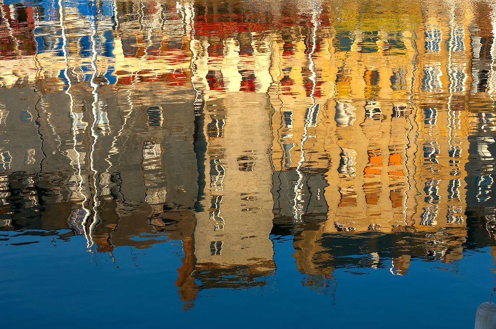 Reflection of harbour buildings and yaughts. Honfleur, Normandy, France. (By Travel photographer Paul Williams. http://funkystockstockphotos.com)
