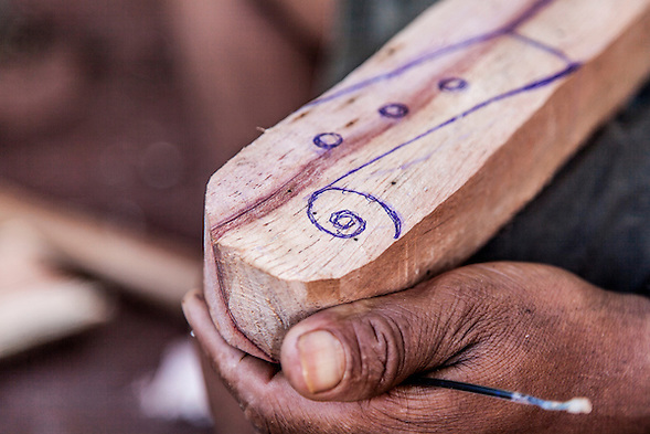 Angel Morinigo, an Mbya Guarani craftsman and musician from Andresito village near San Ignacio, Misiones, Argentina, hand-building a Guarani 3-string violin (rabe). (Jason Rothe)