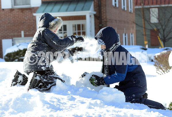 Jonathan Grunde-McLaughlin (left), 8 of Newtown, Pennsylvania throws snow at his brother Andrew Grunde-McLaughlin, 10, also of Newtown, Pennsylvania a day after Winter Storm Jonas Sunday January 24, 2016 in Newtown, Pennsylvania. (Photo by William Thomas Cain) (William Thomas Cain/Cain Images)
