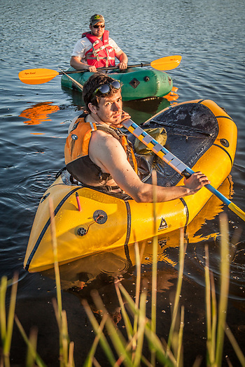 Brothers Brett and Paxon Woelber test their pack-rafts on Anchorage's Westchester Lagoon. (© Clark James Mishler)