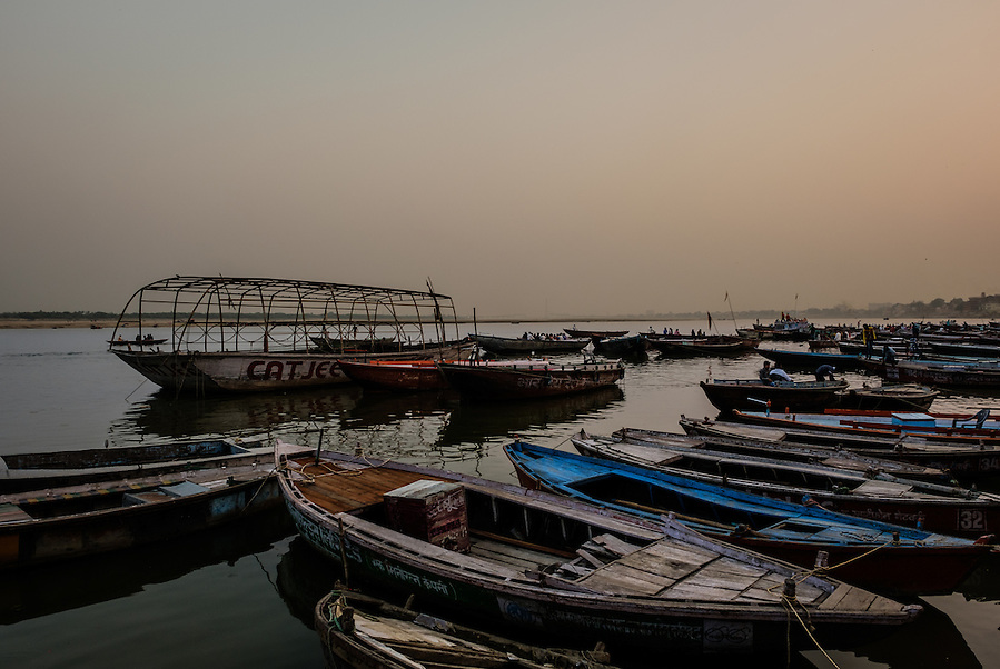 VARANASI, INDIA - CIRCA NOVEMBER 2016: Boats on the Ganges river early morning. The city of Varanasi is the spiritual capital of India, it is the holiest of the seven sacred cities in Hinduism and Jainism. The Ganges is also considered a sacred river. (Daniel Korzeniewski)