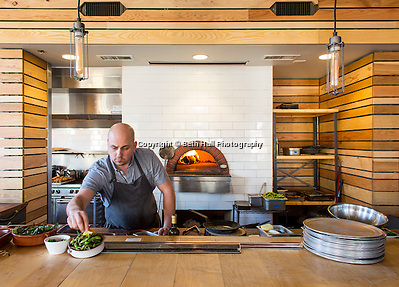 Chef Luke Wetzel prepares food at Oven and Tap on Friday, February 19, 2016, in Bentonville, Arkansas. Beth Hall for the New York Times (Beth Hall)