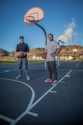 Cousins, Isaiah and Johnny Bueno, shoot hoops in the last light of the day near Calistoga High School. (© Clark James Mishler)