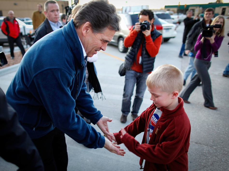 Gov. Rick Perry high-fives seven-year-old Eric Torneten of Harlan, Iowa while campaigning in Carroll, Iowa on Monday, January 2, 2012.  (Christopher Gannon/GannonVisuals.com/MCT) (Christopher Gannon)