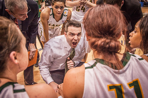 UAA Women Basketball coach Ryan McCarthy tries to rally his team in the final moments of the first game of the  Western Regional Championship at the Alaska Airlines Center in Anchorage.  UAA was upset by Point Loma of California 64-63. (© Clark James Mishler)