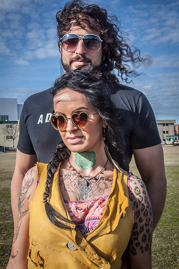 "Tattoo artist Ayla Reynolds with musican David Naathanson on the Delaney Park Strip, Anchorage.   ""I like to keep my life colorful."" (© Clark James Mishler)"
