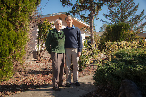 "Nick Hope with his son, George, in front of their home on West Myrtle Street in Calistoga, CA. ""I'm 91, a holocaust survivor and I built 61 homes in this neighborhood in the 1960's and 70's...the streets, the sidewalks, I built it all."" (© Clark James Mishler)"