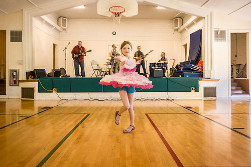 Seven year old Samaria dances to Little Sara and the Nightowls at Phil and Molly Cook's 50th wedding anniversary in Shoreline, Washington. (Clark James Mishler)