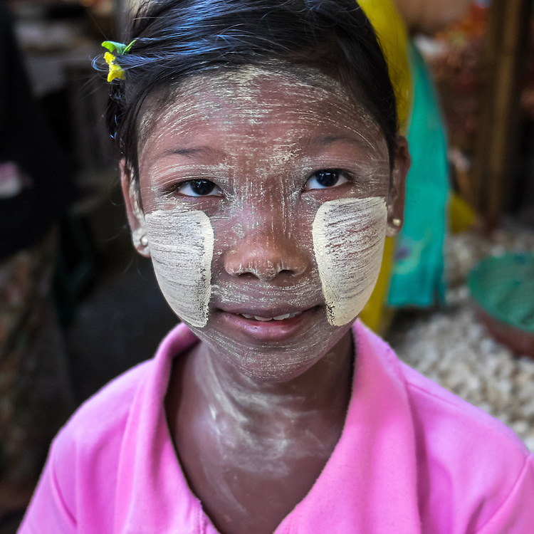 BAGAN, MYANMAR - CIRCA DECEMBER 2013: Portrait of child wearing typical burmese thanaka makeup in the  Nyaung U market close to Bagan in Myanmar (Daniel Korzeniewski)