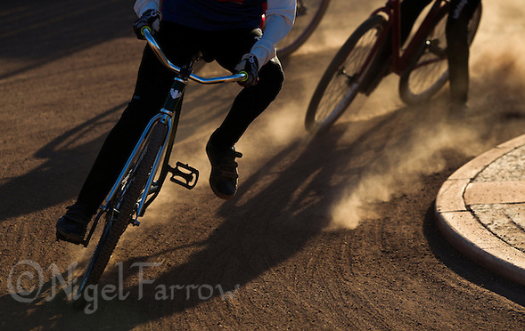 30 JUN 2015 - IPSWICH, GBR - Riders lean into a bend during an Ipswich Cycle Speedway Club training session at Whitton Sports and Community Centre in Ipswich, Suffolk, Great Britain (PHOTO COPYRIGHT © 2015 NIGEL FARROW, ALL RIGHTS RESERVED) (NIGEL FARROW/COPYRIGHT © 2015 NIGEL FARROW : www.nigelfarrow.com)
