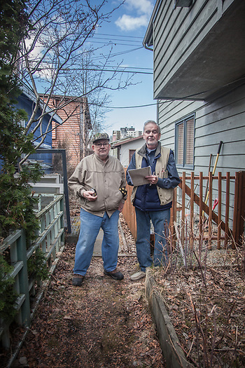 """We both grew up in this neighborhood and we never moved away.  I've been a surveyor since 1953 and I have over 15,000 as-builts filed in my office.  I don't even own a comuputer.""  -Licensed Surveyor R.L. Button (right) with his assistant Nick Ihly in Anchorage's South Addition neighborhood (© Clark James Mishler)"