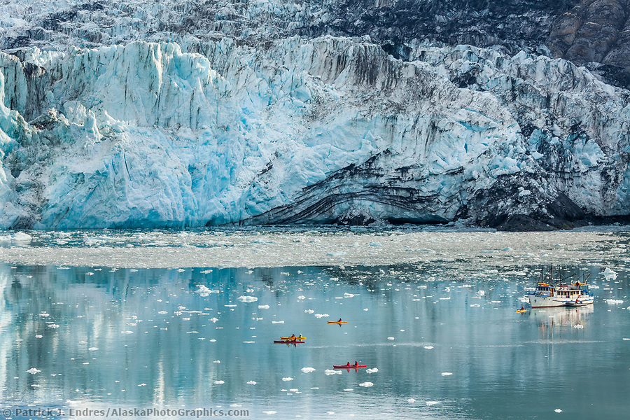 Alaska tourism photos: Kayakers paddle in Barry Arm, near the face of Cascade glacier, Prince William Sound, southcentral, Alaska. (Patrick J. Endres / AlaskaPhotoGraphics.com)